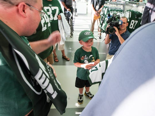 Neal Spickert-Fulton, a 5-year-old Morris Plains cancer patient visits N.Y. Jets/Falcon game at MetLife Stadium as SNYÕs Dream Day winner on August 21, 2015. Neal's eyes light up as he is shown a new Eric Decker football jersey at the Jets Store.