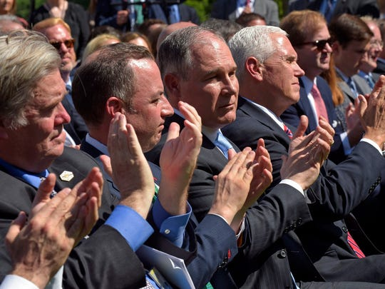 Administration officials -- from left, White House chief strategist Steve Bannon, Chief of Staff Reince Priebus, Environmental Protection Agency Administrator Scott Pruitt and Vice President Mike Pence -- applaud as President Donald Trump announces that the U.S. will withdraw from the Paris climate change accord as he speaks in the Rose Garden of the White House, Thursday, June 1, 2017, in Washington. (AP Photo/Susan Walsh)