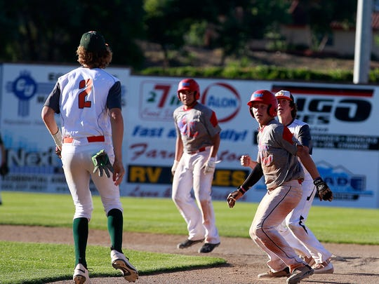 Austin Evans, right, of the ClubSox, gets caught in a rundown during a City League game against the Flat Bill Ducks on Thursday at Ricketts Park in Farmington.