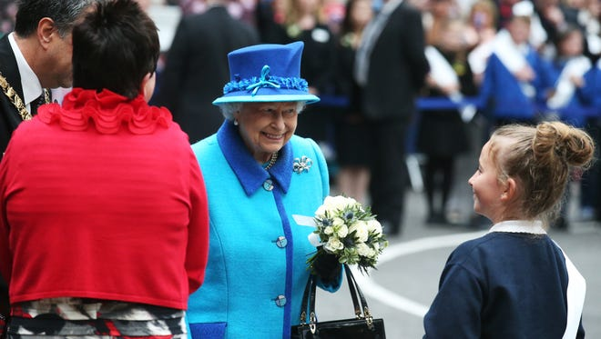 Britain's Queen Elizabeth II, on the day she becomes Britain's longest-reigning monarch, arrives to inaugurate the new multimillion pound Scottish Borders Railway, at Tweedbank, Scotland, on Sept. 9, 2015.