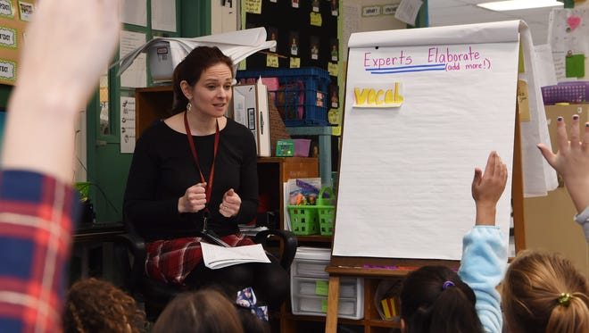 In this January photo, Ali Melious, a second grade teacher at Arlington's Overlook Primary School, goes over vocabulary with students.