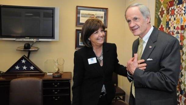 Sen. Tom Carper, D-Del., meets with Paulette Mason, Delaware's fellow for the Elizabeth Dole Foundation, in his Capitol Hill office Thursday.