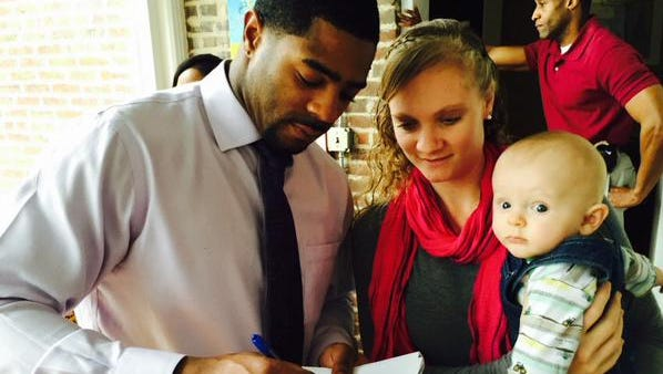 Butler signs an autograph
