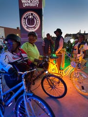 Crystal Edwards, left, and Kim Taylor stand with their bikes lit up on Woodward as part of Dlectricity.