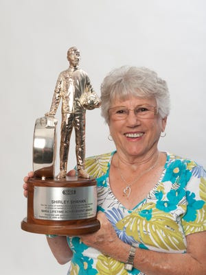 Shirley (Shahan) Bridges, a legendary drag racer from Visalia (now Tulare) shown here with the NHRA Life Achievement Award she earned in 2005, was just inducted into the Mopar Hall of Fame.