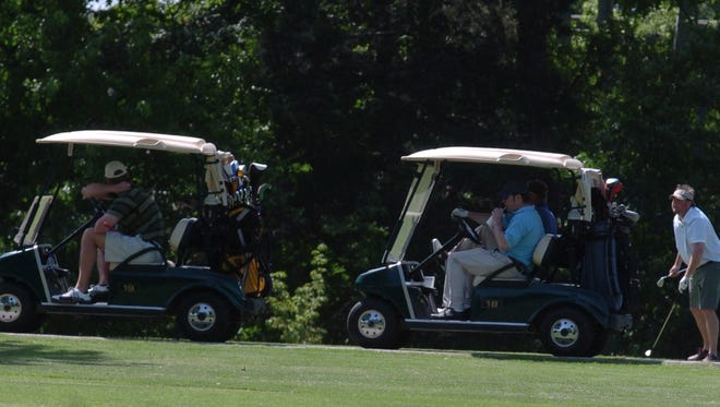 Golfers ride around the Jackson Country Club on as they take part in the Youth Town West Tennessee Healthcare Legacy for Life golf tournament in this 2008 file photo.