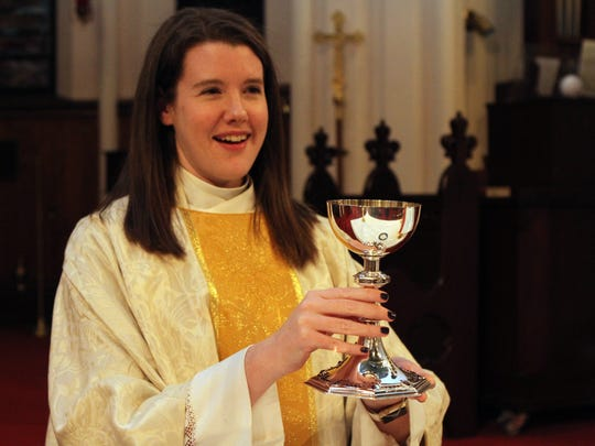 The Rev. Meghan Holland at the altar at Trinity Episcopal