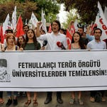 Pro-nationalist university students shout during a protest against U.S.-based cleric Fethullah Gulen and his followers during a demonstration in Ankara, on July 21, 2016.