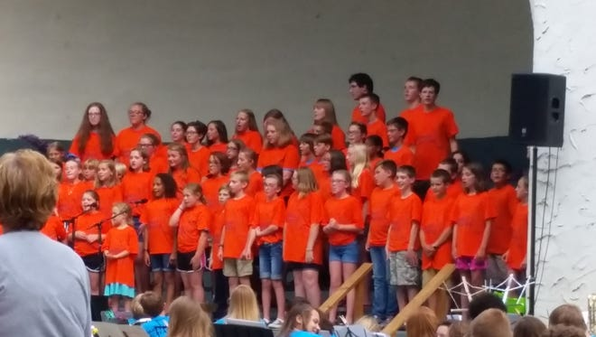 The Summer Singers choir performs at the McKennan Park band shell during the summer of 2016.