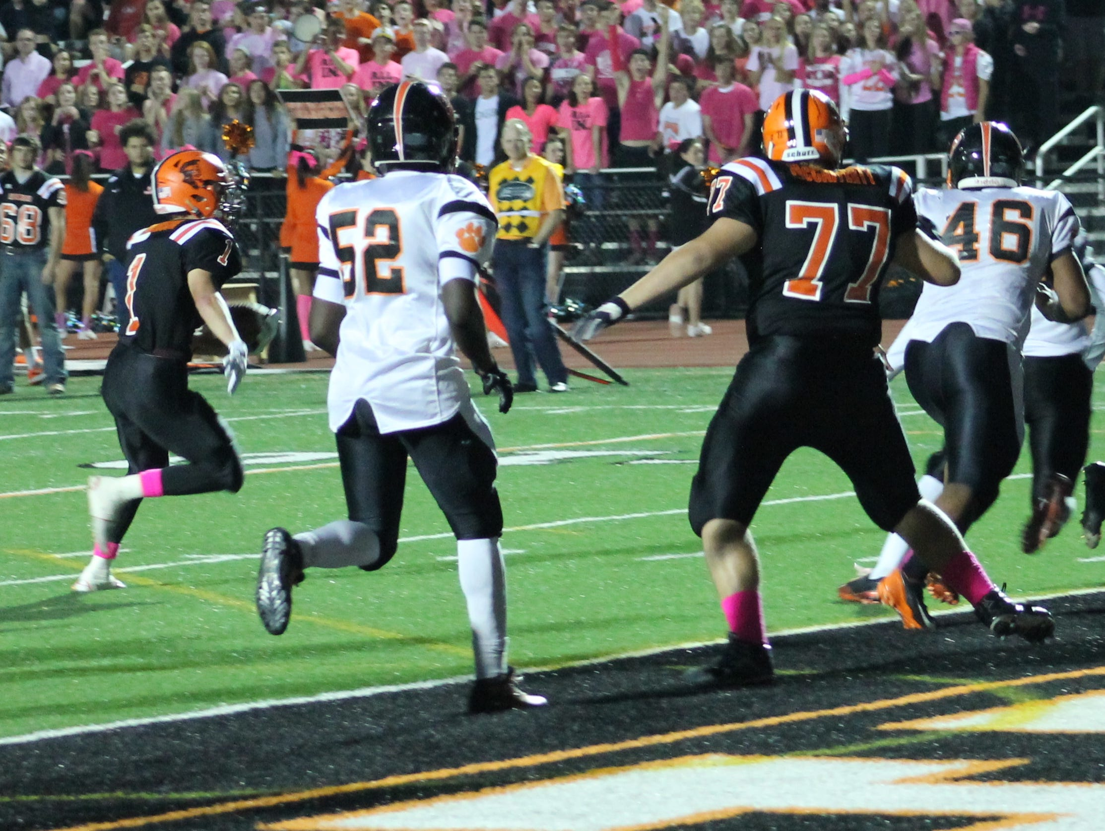 Anderson senior Patrick Johnson (1) heads for the end zone against Withrow.