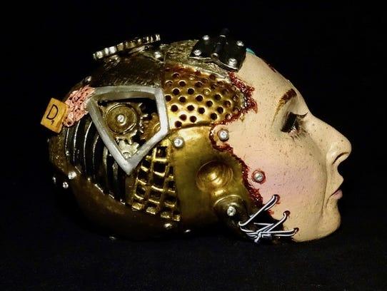 Diane Falcone's ceramic-based skull sculptures are