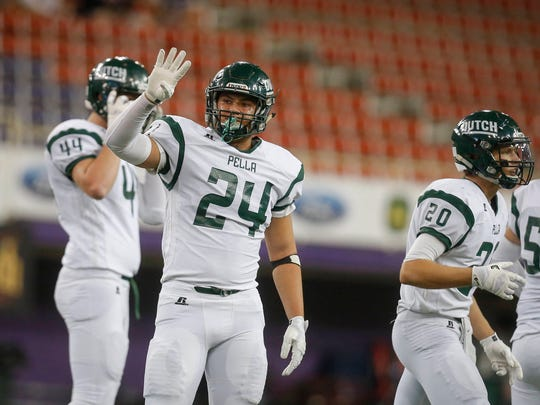 Pella linebacker Lucas Warner calls a defensive play against Webster City on Thursday, Nov. 17, 2016, during the 2016 Iowa high school Iowa Class 3A football championships at the UNI-Dome in Cedar Falls.