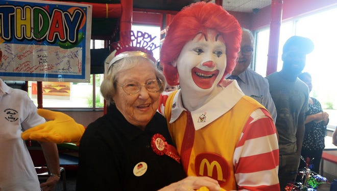 """Martha Reves takes a photo with Ronald McDonald during her 95th birthday celebration Tuesday morning at McDonald's on North Highland Avenue, where she has worked for 25 years. """"This is so exciting,"""" Ronald McDonald said. """"She is one of the happiest people I've ever met — and I'm lovin' it."""""""