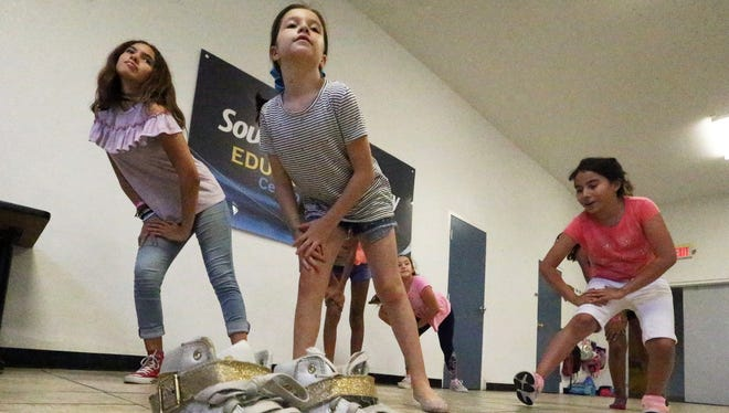Sophia Morales, center, works on a dance routine July 12 with other girls in a summer camp at the Boys & Girls Clubs of El Paso at 801 S. Florence St., in South El Paso.