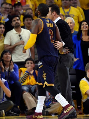 Cleveland Cavaliers guard Kyrie Irving (2) walks off the court after being injured during the fourth quarter in Game 1 of the NBA Finals against the Golden State Warriors.