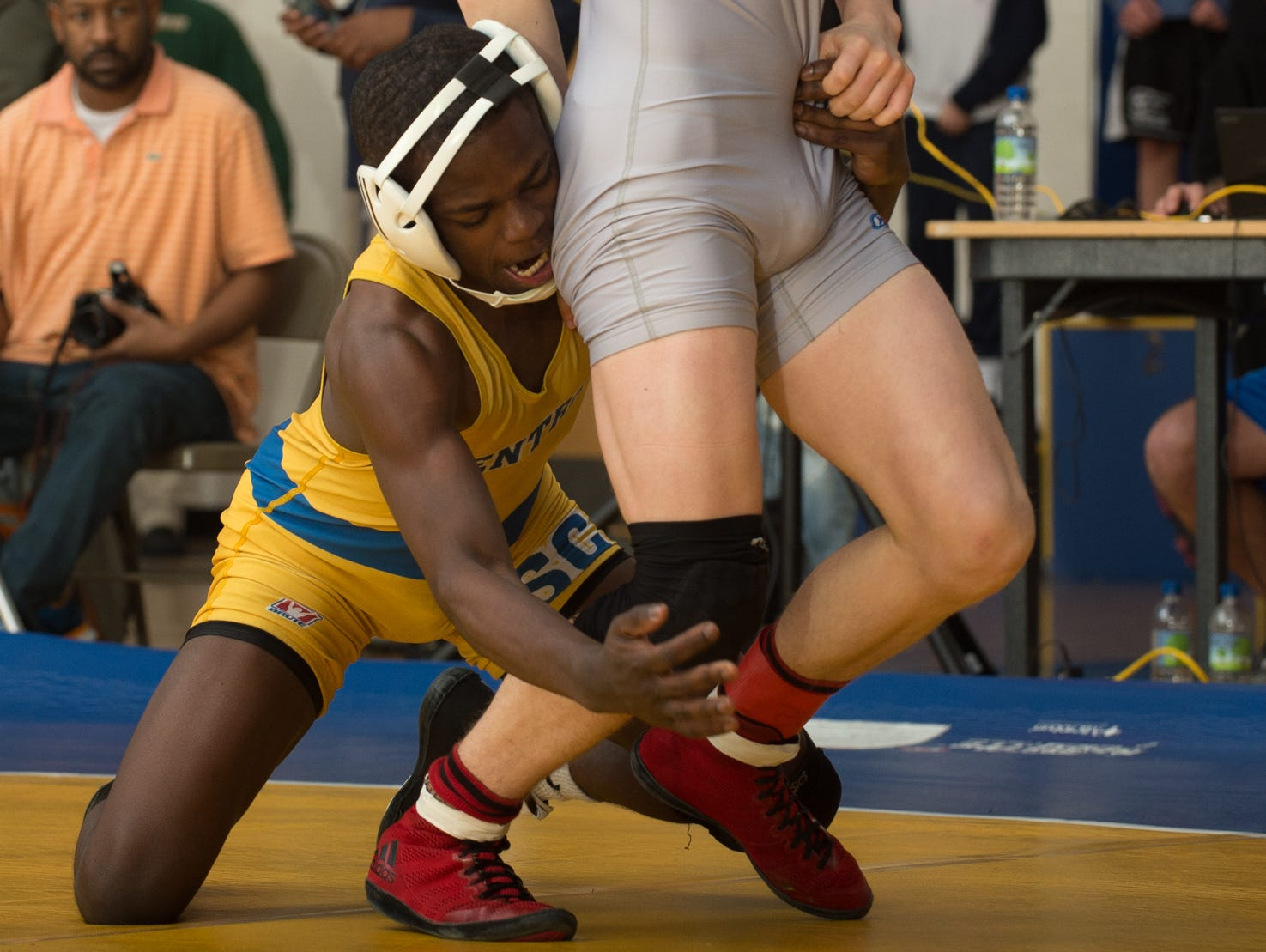 Sussex Central's Rashad Stratton goes for the legs of Smyrna's Cole Sebastianelli in the 126 pound championship match at the Henlopen Conference wrestling tournament at Sussex Central High School.