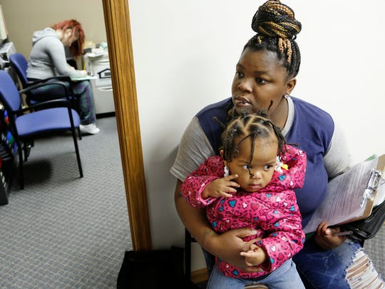Taché Foster, 21, and waits with her daughter Da'Maya Johnson, 1, to meet with a Housing Technician to apply for a Section 8 voucher Wednesday, May 6, 2015, at Lafayette Housing Authority, 100 Executive Drive, Lafayette. The wait list for Section 8 vouchers keeps growing, surpassing the cutoff point of 500 people. Executive Director Michelle Reynolds doesn't want to close the wait list, however, because it gives people hope.