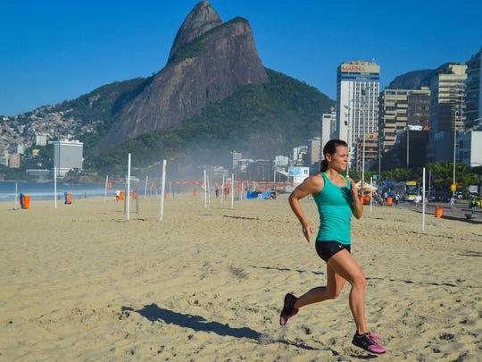 Collette Stohler runs on the beach in Rio de Janeiro, Brazil