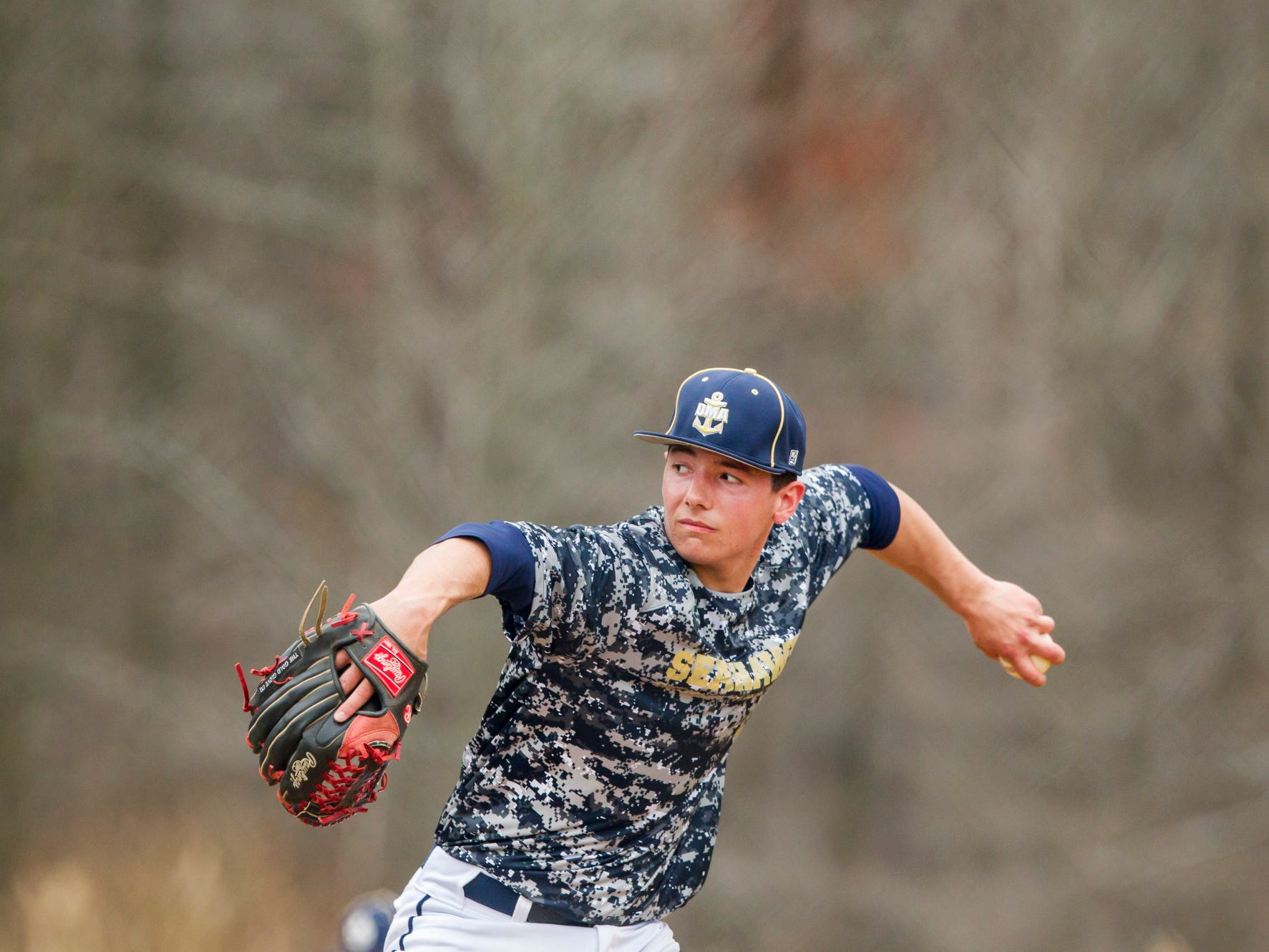 Delaware Military Academy pitcher Vincent Ruggiero delivers a pitch during a game at Newark National field on Tuesday afternoon.
