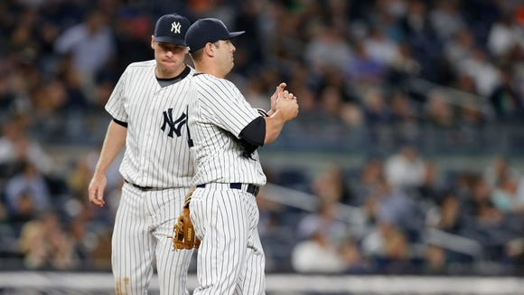 New York Yankees third baseman Chase Headley (12) consoles Yankees relief pitcher Nick Goody (41) who gave up a two-run single to Kansas City Royals Lorenzo Cain (6)  in the sixth inning of a baseball game at Yankee Stadium in New York, Wednesday, May 11, 2016.