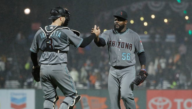 Arizona Diamondbacks relief pitcher Fernando Rodney, left, celebrates with catcher Chris Iannetta (8) after recording the last out of the game in a 4-3 win over the San Francisco Giants during a baseball game Tuesday, April 11, 2017, in San Francisco.