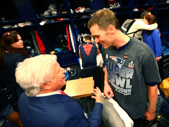 New England Patriots quarterback Tom Brady (right) talks with team owner Robert Kraft in the locker room after defeating the Atlanta Falcons during Super Bowl LI at NRG Stadium.