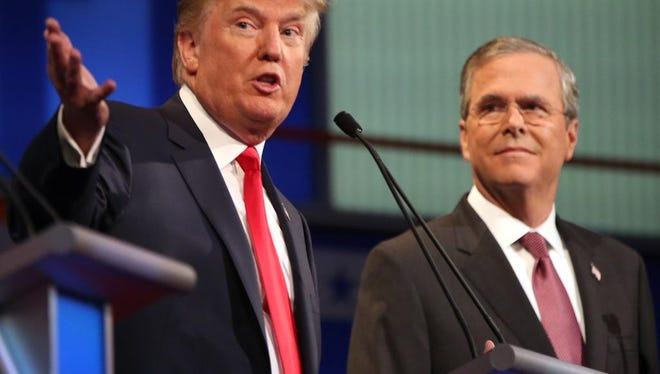 Republican presidential candidates Donald Trump and Jeb Bush participate in the first Republican presidential debate at the Quicken Loans Arena in Cleveland on Aug. 6, 2015.