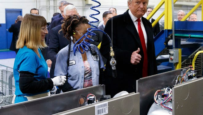 Donald Trump meets workers at Carrier plant in Indianapolis. Carrier agreed to keep some jobs from going to Mexico, but other U.S. companies have found it difficult not to go to Mexico because of cost savings/