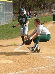 Spackenkill's Maddie McCall prepares to slide into home as Webutuck's Kate Louey attempts to block the base during an April 2016 game.