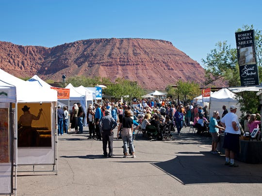 Artists showcase their pieces in Kayenta with the cliffs