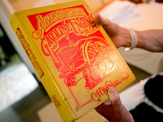 """Edgewater Haven Nursing Home resident Orville Schraeder of Port Edwards holds up his """"bible"""", a copy of """"American Gasoline Engines Since 1872"""", Thursday, Sept. 10, 2015.  Orv's Old Iron Show will be held in the Edgewater Haven parking lot from 10 a.m. to 2 p.m."""