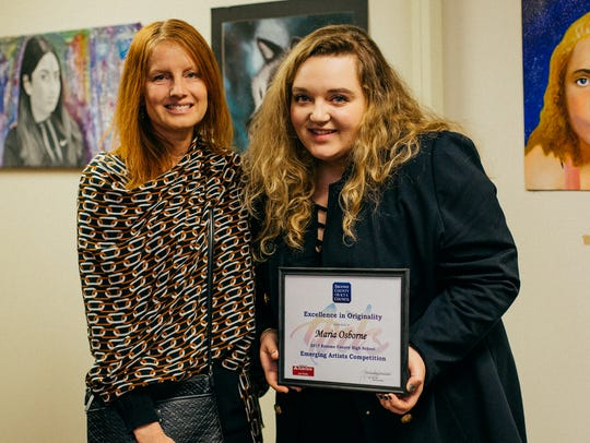 Maria Osborne and her art teacher, Kellie Smith.