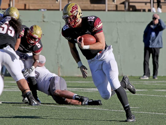Midwestern State quarterback Layton Rabb runs for a