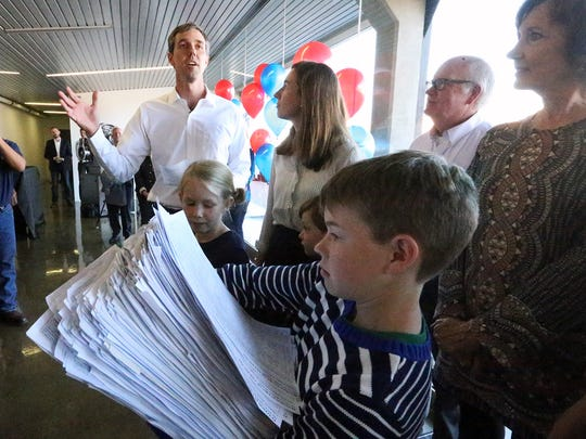U.S. Rep. Beto O'Rourke, D-El Paso, speaks to supporters as he formally enters the race for the U.S. Senate on Monday at an office building at 500 W. Overland Ave. in Downtown. His son, Ulysses, 11, holds a stack of nearly 15,000 signatures gathered on a statewide petition. Next to O'Rourke is his wife, Amy.