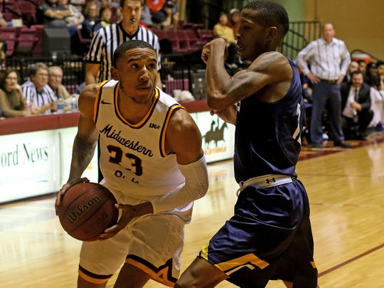 Midwestern State's Charles Callier drives to the basket