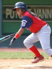 Guam's Merced Flores, the only girl playing in the 2003 Little League World Series, watches as she singles in the sixth inning against Mexico in this Aug. 18, 2003, file photo taken in South Williamsport, Pa.