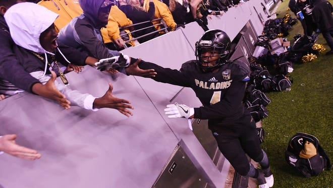 Paramus Catholic's Khyon Fitzpatrick celebrates with fans after the end of the Non-Public Group 4 state final at MetLife Stadium on Friday, Dec. 2, 2016.