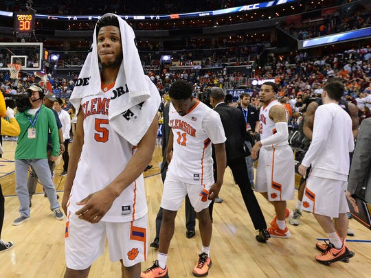 Clemson forward Jaron Blossomgame (5) leaves the court after the Tigers 88-85 overtime loss to Georgia Tech in the Atlantic Coast Conference tournament, on Wednesday, March 9, 2016, in Washington.