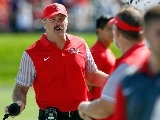 Illinois State head coach Brock Spack, left, talks to his team during the first half of an NCAA college football game against Northwestern in Evanston, Ill., Saturday, Sept. 10, 2016. (AP Photo/Nam Y. Huh)