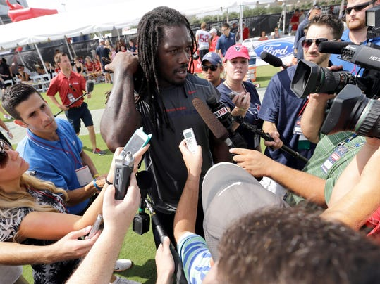 Houston Texans linebacker Jadeveon Clowney talks with members of the media after an NFL football training camp practice Saturday, July 26, 2014, in Houston. (AP Photo/David J. Phillip)