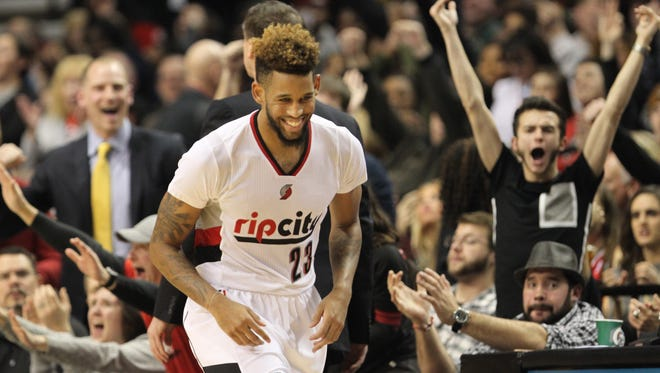 Portland Trail Blazers forward Allen Crabbe (23) celebrates after making his 23rd point against the Cleveland Cavaliers at Moda Center at the Rose Quarter.