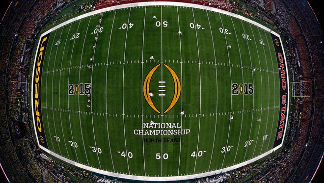 Ohio State and Oregon faced off in the inaugural College Football Playoff National Championship Game on Jan. 12, 2015 in Arlington.