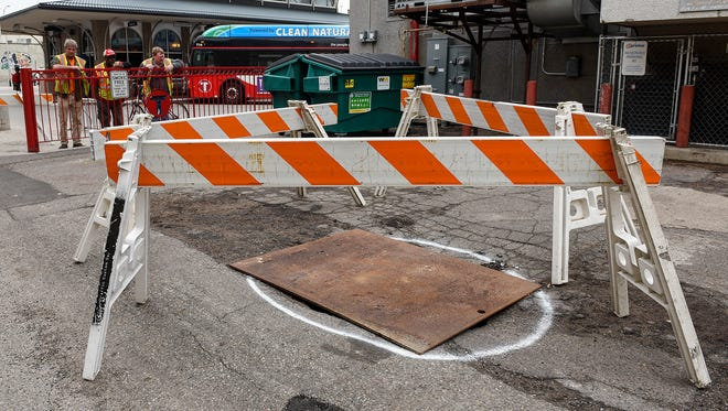 A sink hole opened up into a what was a former basement to a building Tuesday, May 22, the alley behind the Davidson Opera House.