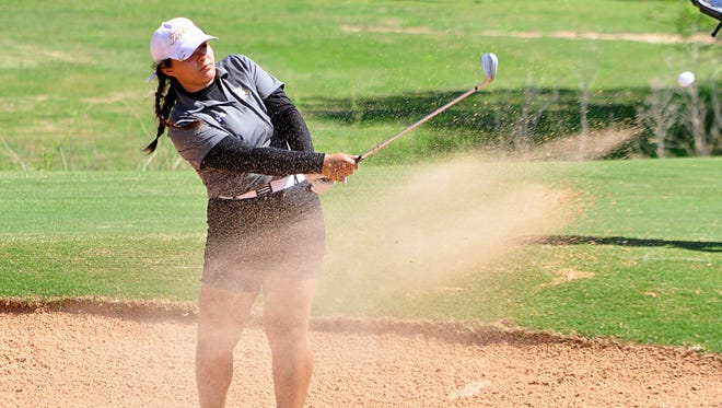 Abilene High's Brie Embers hits out of a sand trap on No. 18 during the second round of the District 3-6A girls golf tournament Thursday at Diamondback Golf Club.