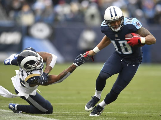 Titans wide receiver Rishard Matthews (18) pulls away from Rams cornerback Trumaine Johnson (22) for a first-down catch during the second half at Nissan Stadium Sunday, Dec. 24, 2017 in Nashville, Tenn.