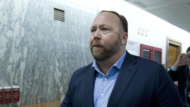 In this Wednesday, Sept. 5, 2018, file photo, Alex Jones, the right-wing conspiracy theorist, walks the corridors of Capitol Hill after listening to testimony on Capitol Hill in Washington.