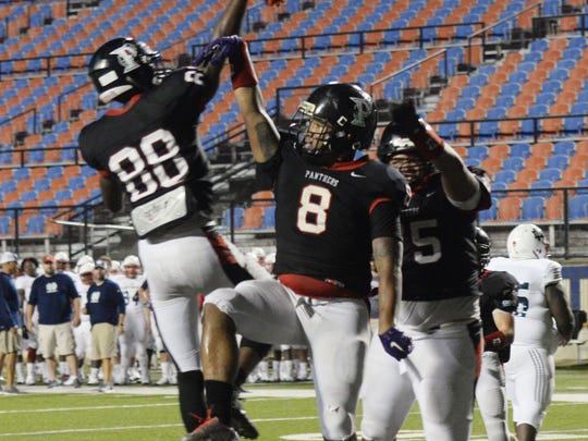 Parkway's Kendall Brown (8) celebrates with wide receiver Terrace Marshall following a touchdown.