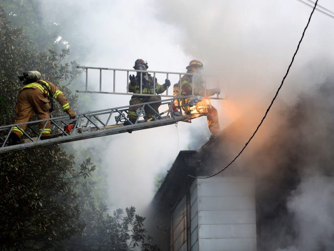 Crews battle a house fire that shut down Beechmont Avenue for several hours Wednesday morning.