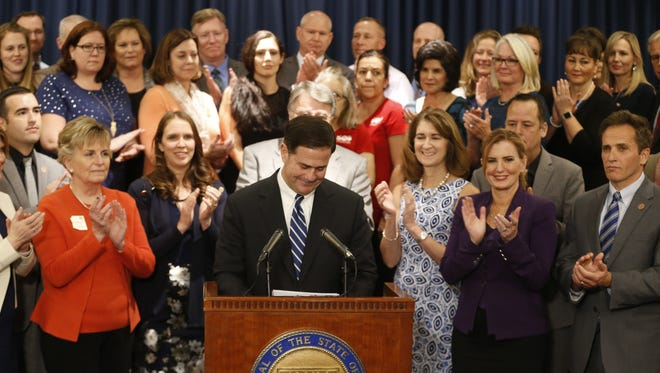 Gov. Doug Ducey announces his plan to raise teachers pay by 20 percent over the next two years at the State Capitol in Phoenix on April 12, 2018.