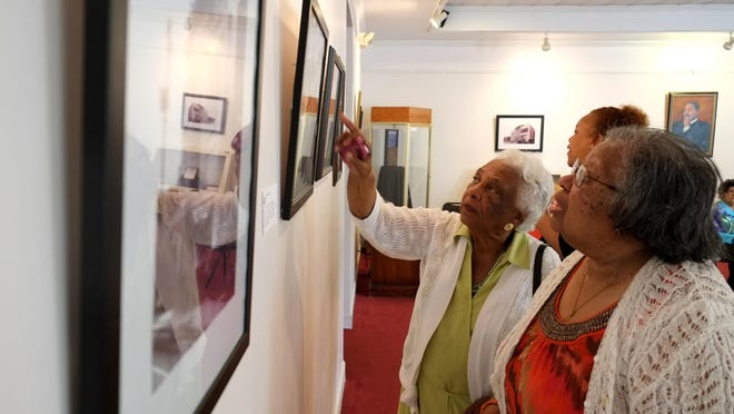 Visitors look at photographs on display at the Lucy Craft Laney Museum of Black History in Augusta.